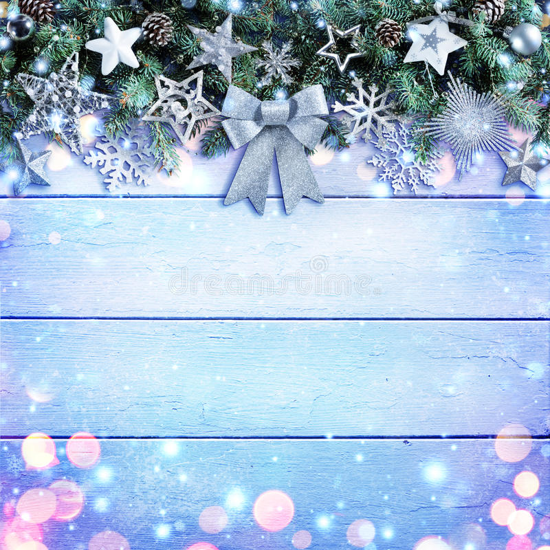 Christmas Garland With Bow And Silver Ornament On Wooden Background royalty free stock image