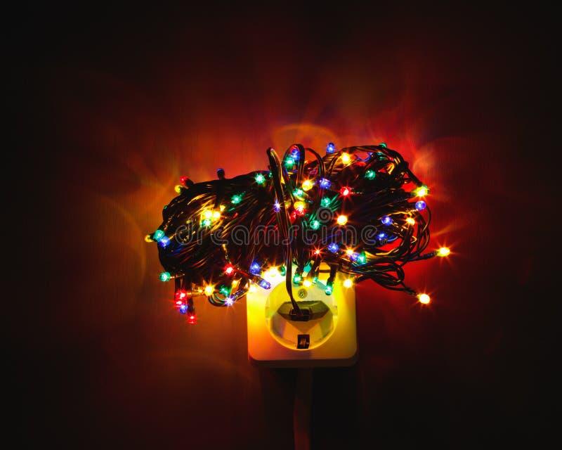 Download Christmas Garland Lights Bundle On Power Socket Stock Image    Image Of Dark, Conceptual