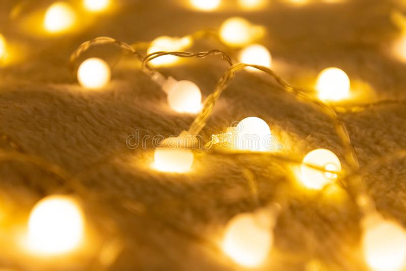 Christmas garland lights from LED bulbs on the carpet background.  royalty free stock photo