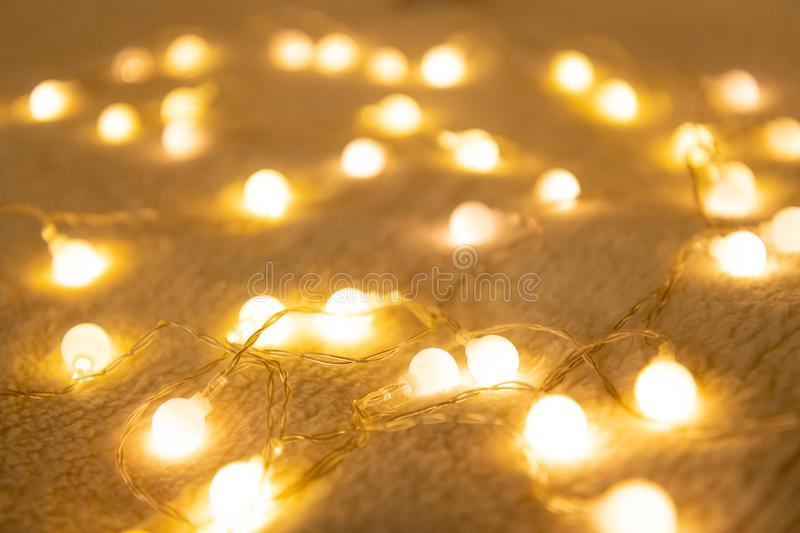 Christmas garland lights from LED bulbs on the carpet background.  royalty free stock images