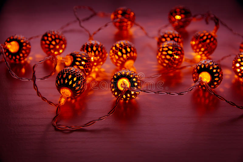 Christmas garland lights on wooden background. royalty free stock images