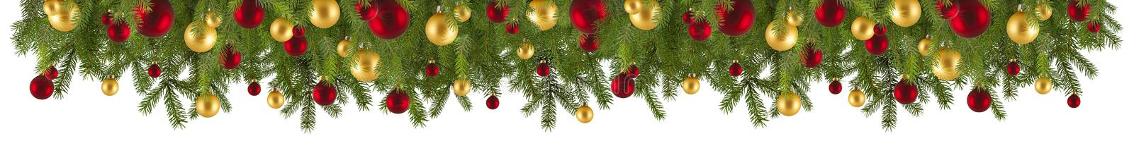 Christmas garland with ornaments and fir branches royalty free stock photography