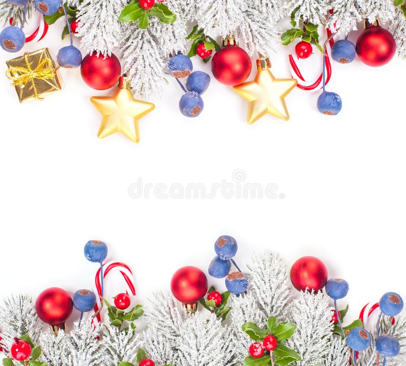 Christmas garland with red and blue berries, golden gift and winter fir border isolated on white background.  royalty free stock image