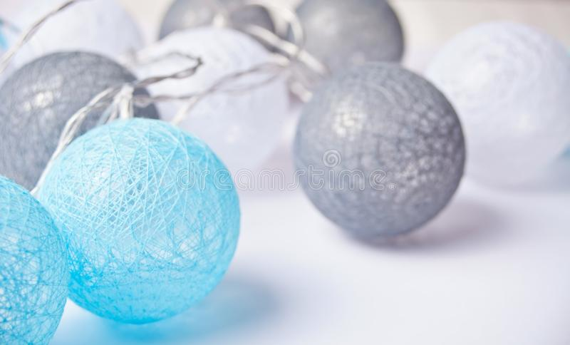 Christmas garland white, gray and blue balls for the Christmas and New year. Christmas decorations stock photo