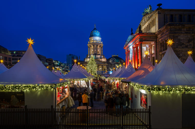 Christmas at Gendarmenmarkt in Berlin, Germany. Two of Berlin's landmarks - Deutscher Dom and Konzerthaus in the historic Gendarmenmarkt make a great backdrop royalty free stock images