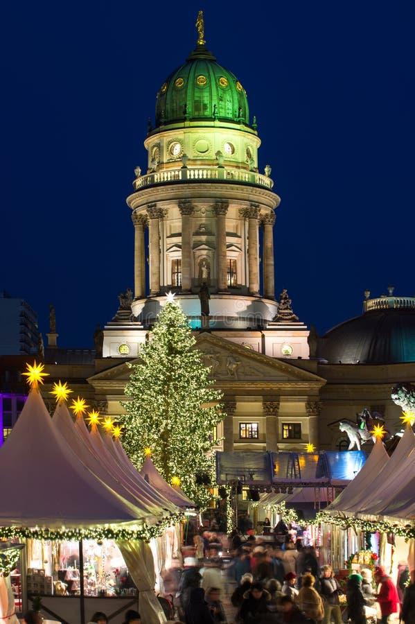 Christmas at Gendarmenmarkt in Berlin, Germany. Two of Berlin's landmarks - Deutscher Dom and Konzerthaus in the historic Gendarmenmarkt make a great backdrop royalty free stock image