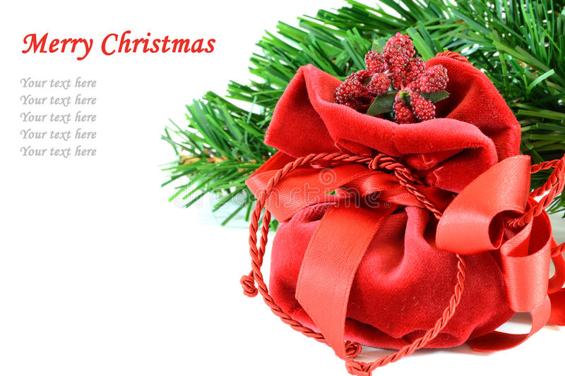 Christmas gift. Red Christmas gift box and Cristmas tree branch on white background