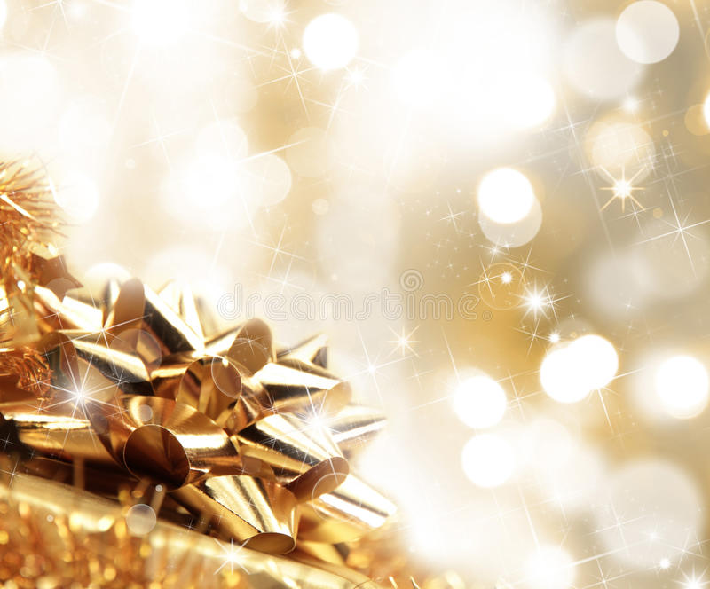 Christmas gift. With golden background stock image