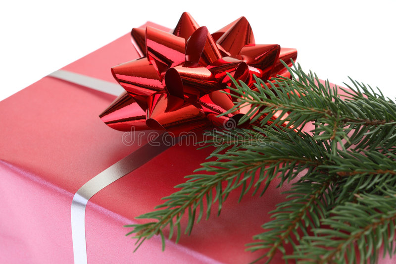 Christmas gift. With the red ribbon and a piece of christmas tree royalty free stock photography