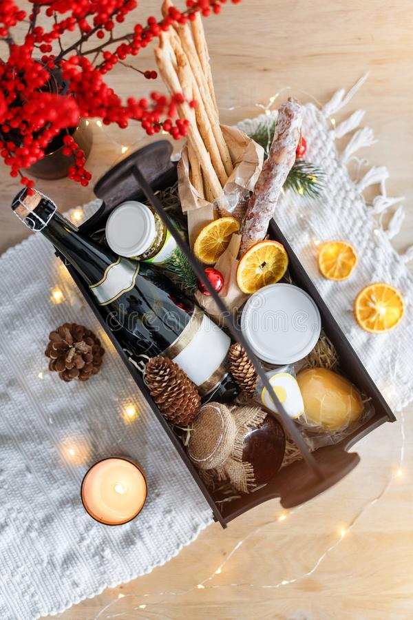 Christmas gift basket with food and decorations. royalty free stock photos
