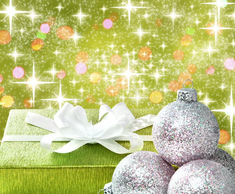 Christmas gift and baubles. On the old gold background vector illustration