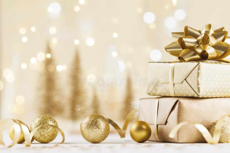 Christmas gift box against golden bokeh background. Holiday greeting card. Christmas gift box against golden bokeh background. Holiday card stock photos