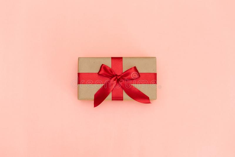Christmas gift box against turquoise bokeh background. Holiday greeting card. Christmas gift box against on pink background. Holiday greeting card stock image