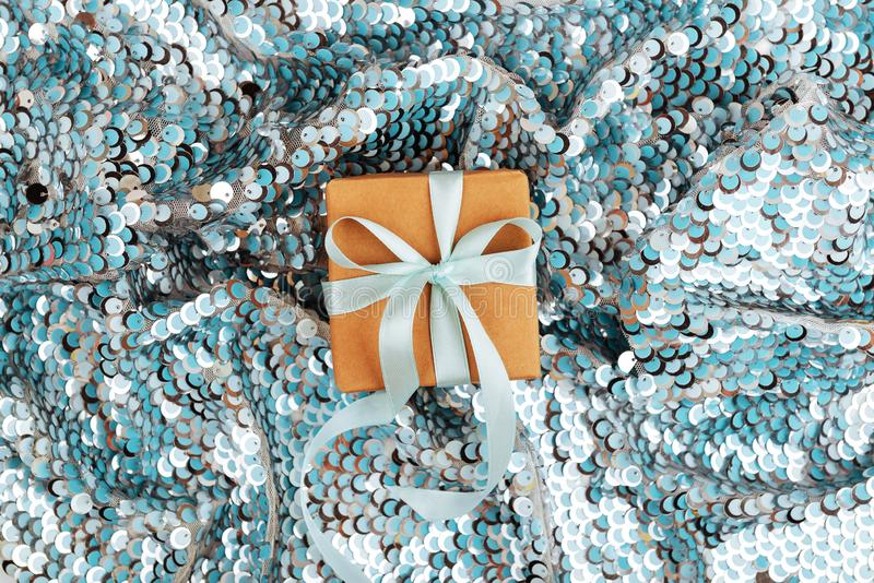Christmas gift box against turquoise bokeh background. stock images