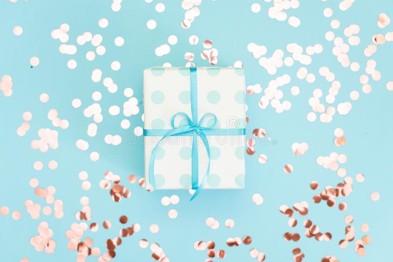 Christmas gift box against turquoise bokeh background. Holiday greeting card royalty free stock photo