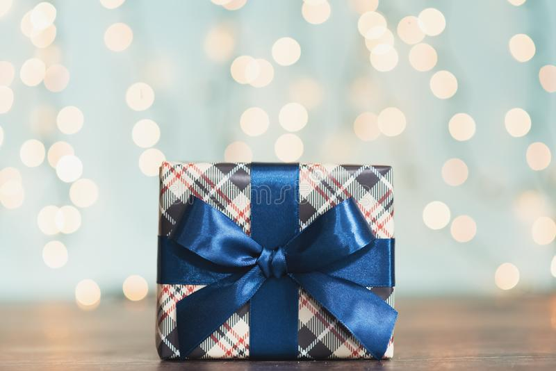 Christmas gift box against turquoise bokeh background. Holiday greeting card.  royalty free stock photos