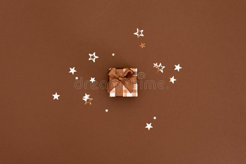 Christmas gift box against turquoise bokeh background. Holiday greeting card.  royalty free stock images