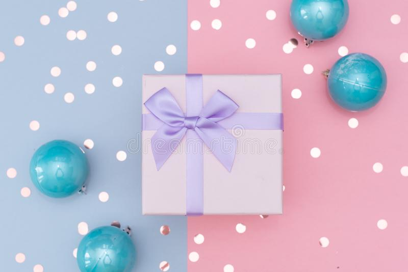Christmas gift box against turquoise bokeh background. Holiday greeting card royalty free stock photos
