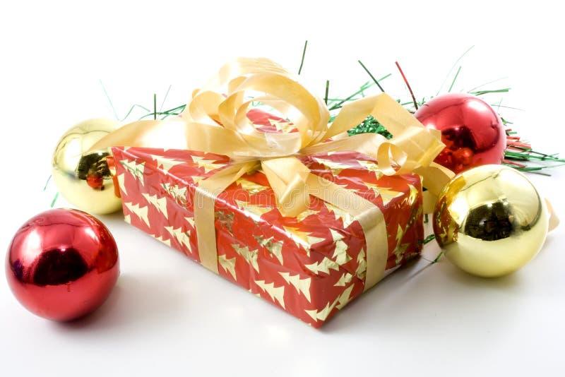 Christmas gift box and balls stock photos