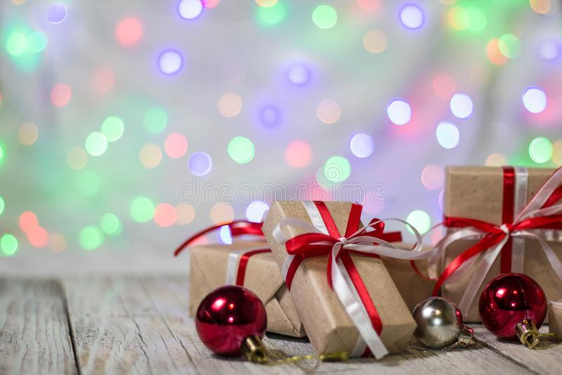 Christmas gift box with balls against bokeh background. Holiday greeting card royalty free stock images