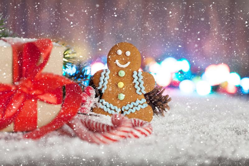 Christmas gift box, candy canes and gingerbread man. Christmas gift box, candy canes, gingerbread man and snow fir tree. Xmas greeting card with copy space stock photography