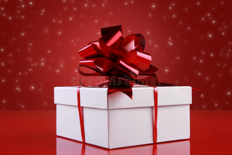Christmas gift box with a dark-red ribbon bow