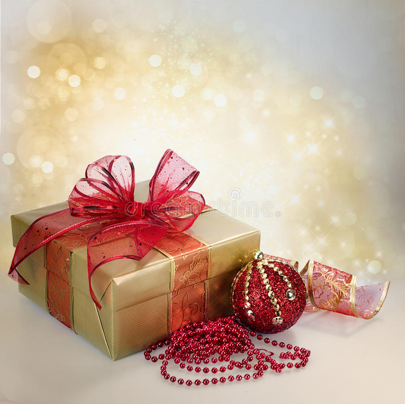 Christmas Gift Box and Decorations in Gold and Red. Still life of christmas and New Year gift and decorations with copyspace royalty free stock photography