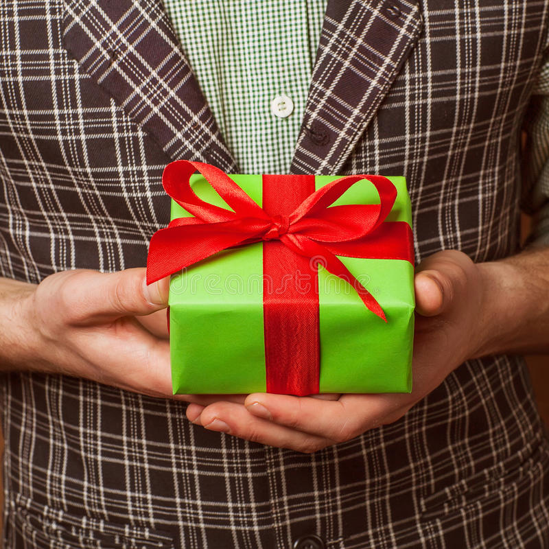 Christmas gift box with hand royalty free stock photos