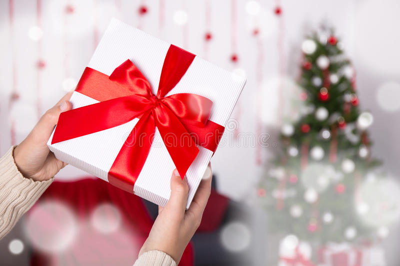 Christmas gift box in male hands. Close up of christmas gift box in male hands royalty free stock image