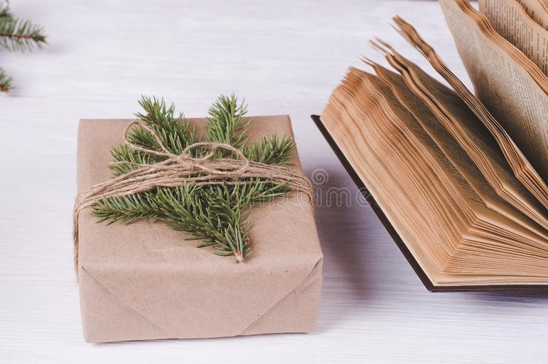 Christmas gift box and old books on a white wooden background. Christmas & New Year leisure concept stock image