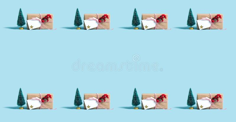 Christmas gift box pattern. On a blue background royalty free stock image