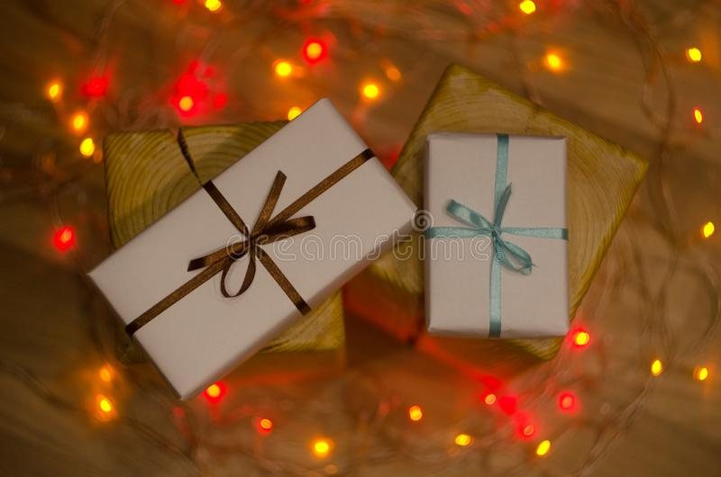 Christmas gift box or present with ribbon on magic bokeh background royalty free stock images