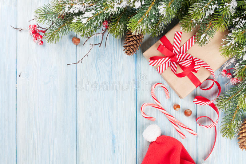Christmas gift box and tree branch stock images