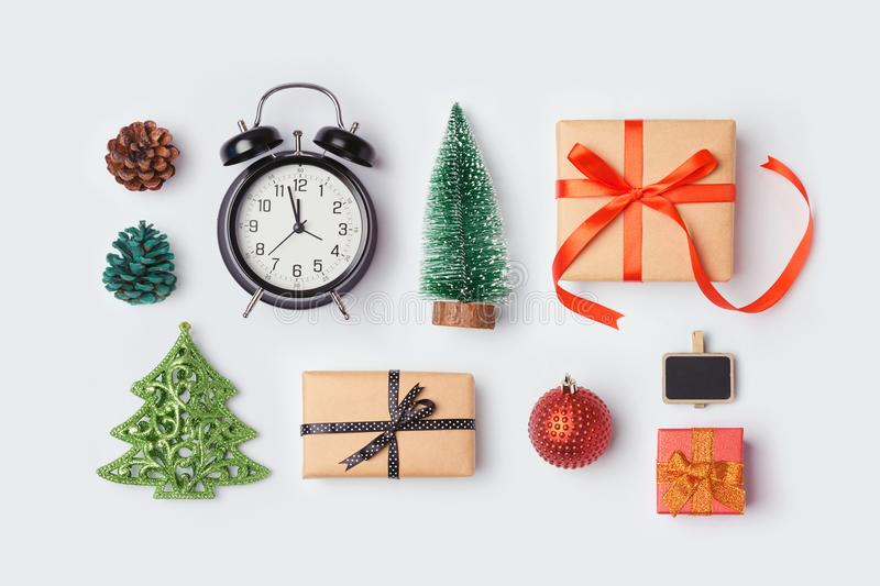 Christmas gift boxes, alarm clock, pine tree stock photos