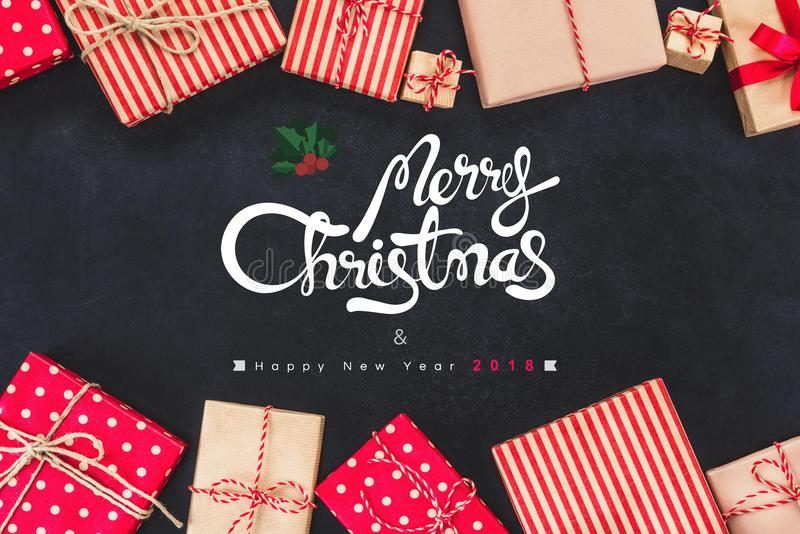 Christmas gift boxes on black background with new year wishes 2018 royalty free stock photo