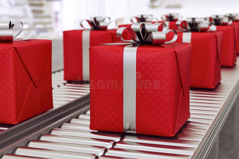 Christmas gift boxes on conveyor rollers ready to be shipped by courier for distribution. Red gift boxes on conveyor belt in time for christmas stock photography