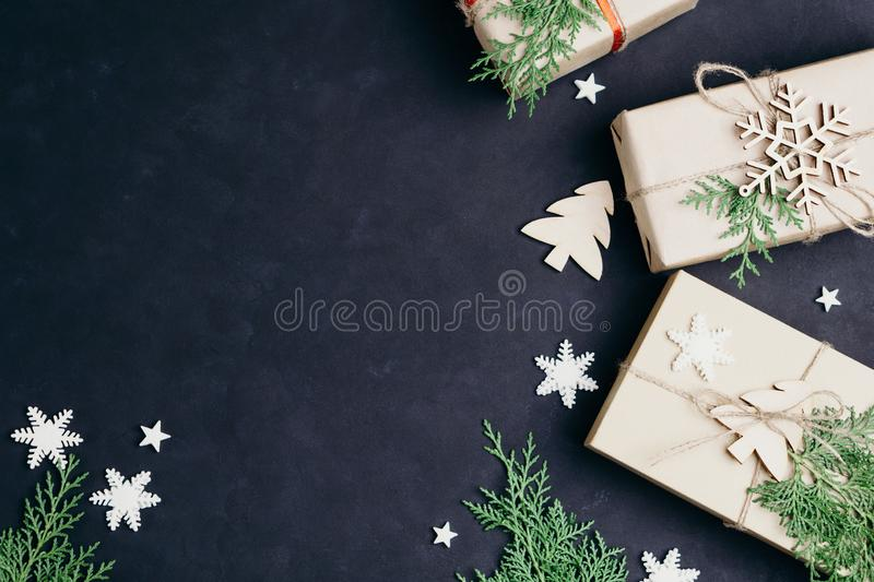 Christmas gift boxes on dark background, flat lay royalty free stock images