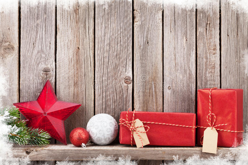 Christmas gift boxes and decor in front of wooden wall. View with copy space for your text royalty free stock images