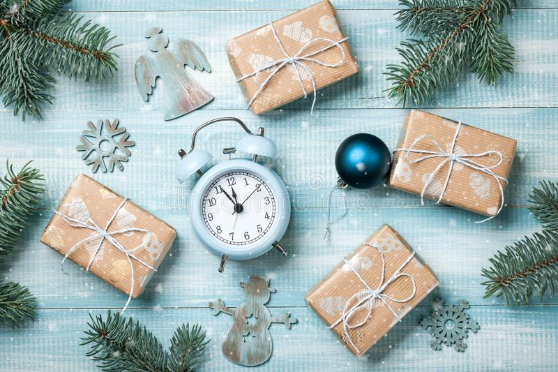 Christmas gift boxes decoration and alarm clock on wooden background stock image