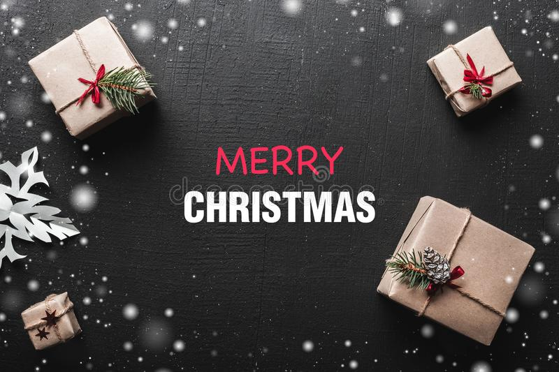 Christmas gift boxes and decorations on dark table. Xmas background, top view with copy space. stock photo