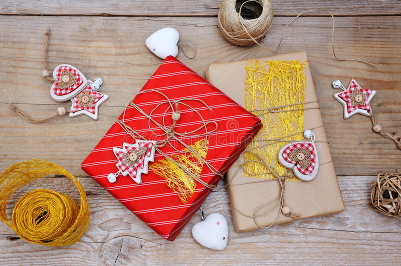 Christmas gift boxes and decorations for the tree on wooden background stock photography