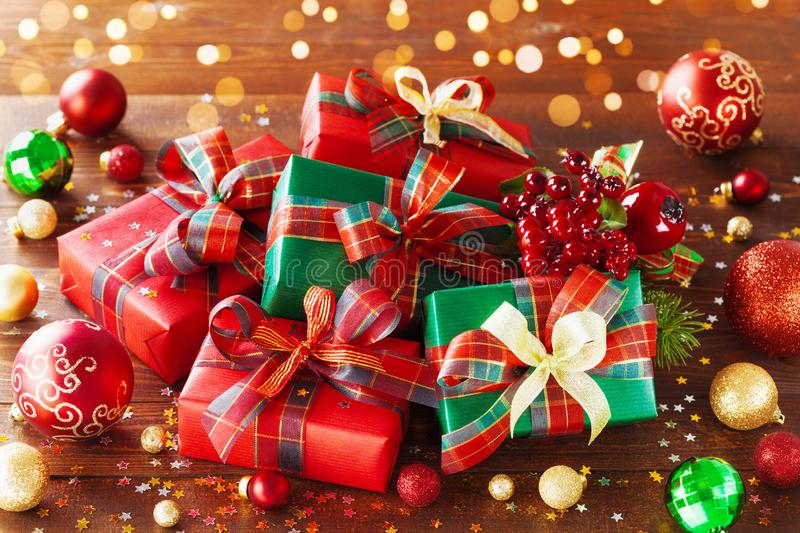 Christmas gift boxes with holiday lights on wooden background stock photography
