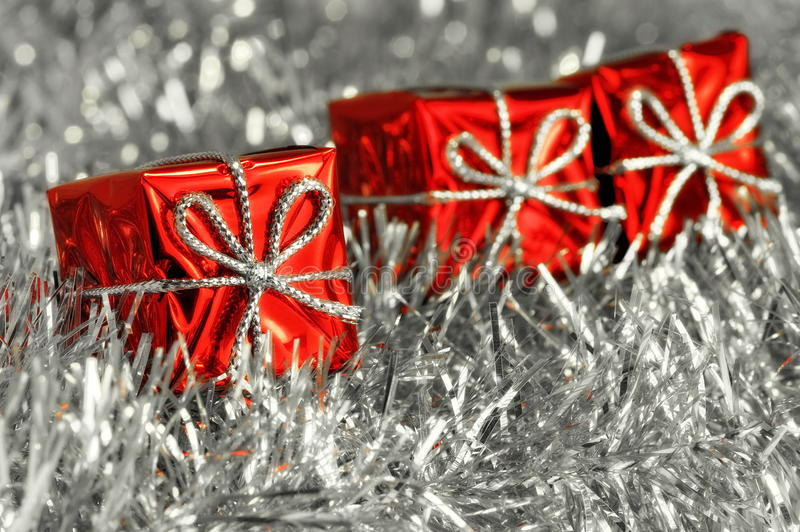 Red Christmas gift boxes and silver tinsel stock image