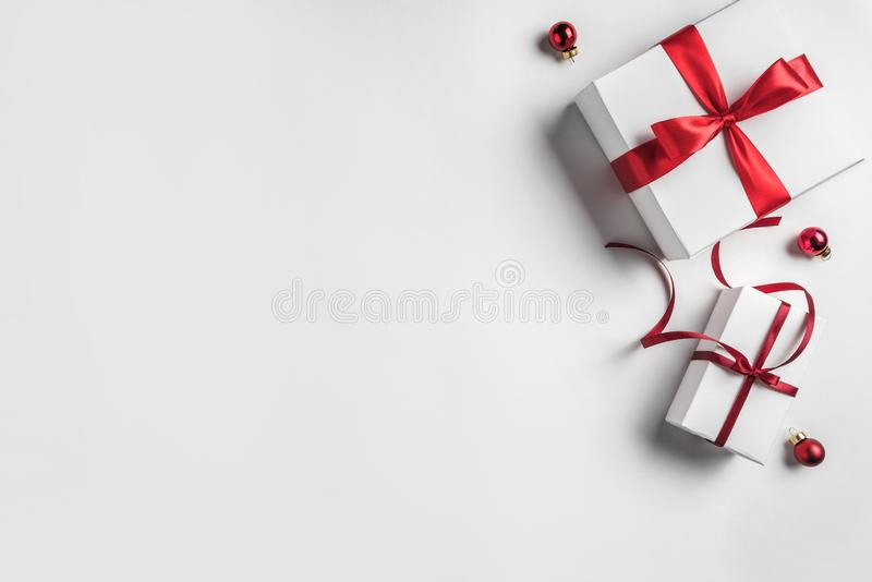 Christmas gift boxes with red ribbon and decoration on white background. Xmas and Happy New Year theme. Flat lay, top view royalty free stock images