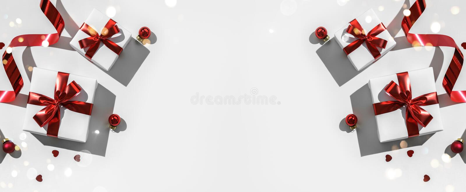 Christmas gift boxes with red ribbon and decoration on white background. Xmas and Happy New Year holiday, bokeh, light. Flat lay. Top view, harsh shadow stock images