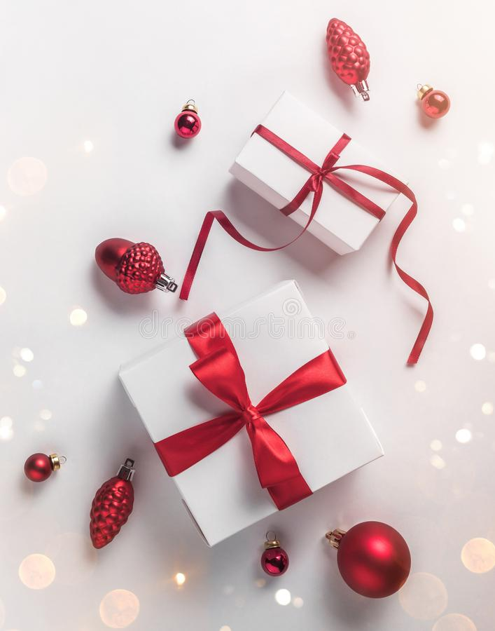 Christmas gift boxes with red ribbon and decoration on white background. Xmas and Happy New Year theme, snow. Flat lay. Top view stock photo