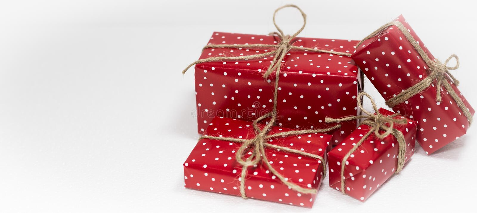 Christmas gift boxes on white background with empty space for text royalty free stock photo