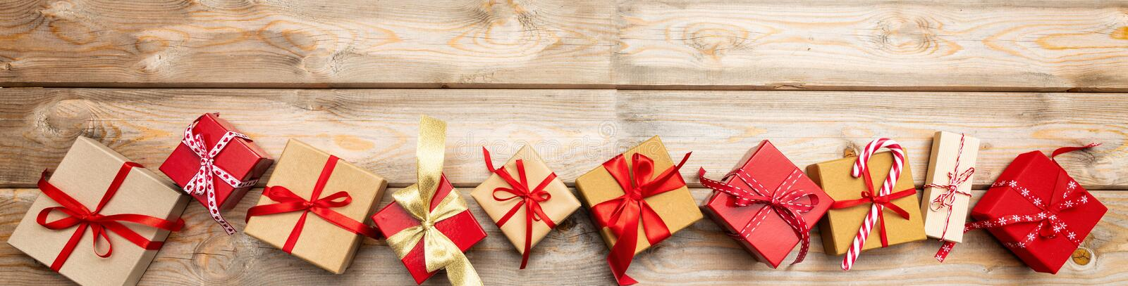 Christmas gift boxes on wooden background, banner, copy space, top view royalty free stock photography
