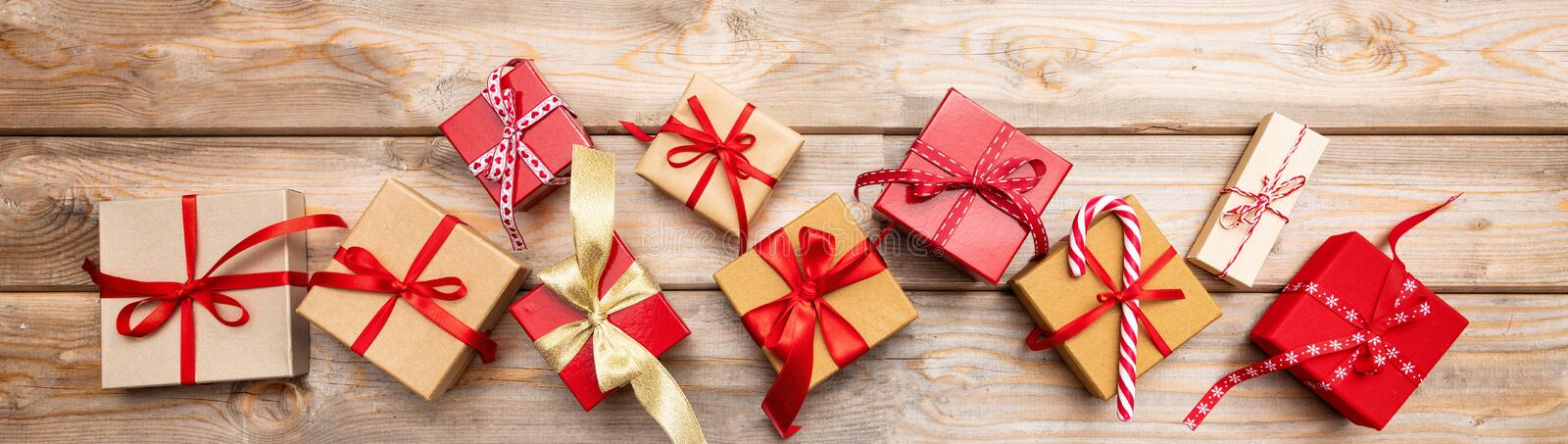 Christmas gift boxes on wooden background, banner, top view royalty free stock photos