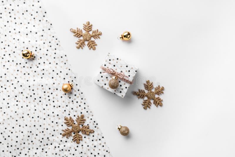 Christmas gift boxes on wrap background with gold decoration and pine cones. Xmas and Happy New Year theme. Flat lay, top view, wide composition stock images